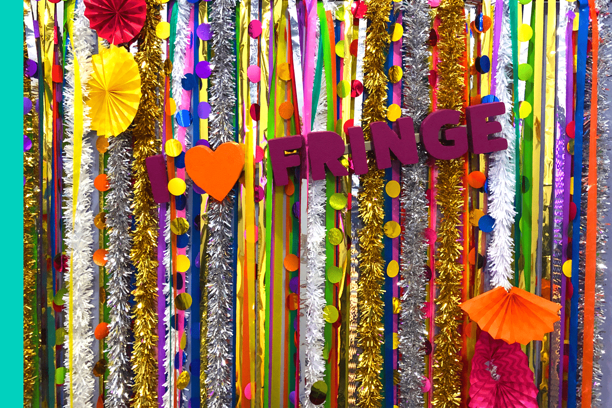 Image of a banner of garlands with foam letters that read I heart Fringe.
