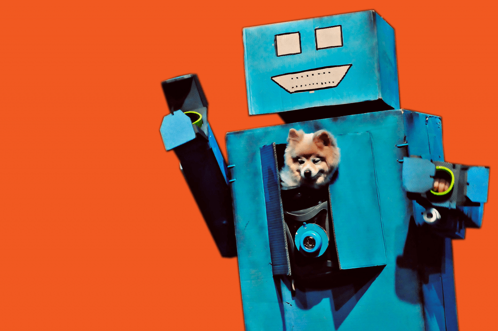 A blue robot made of cardboard with a small dog in its chest.