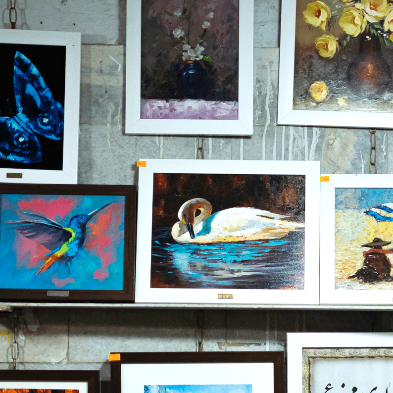 Photo of art on display and for sale on a shelf.