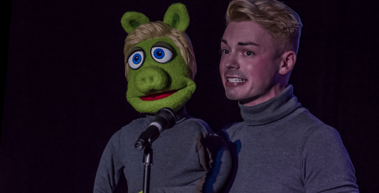 Performer Joel Swanson on stage with his Frogpig puppet