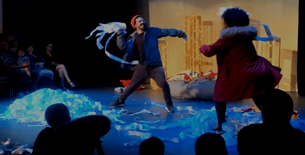 Performers on stage, having a snowball fight with toilet paper.