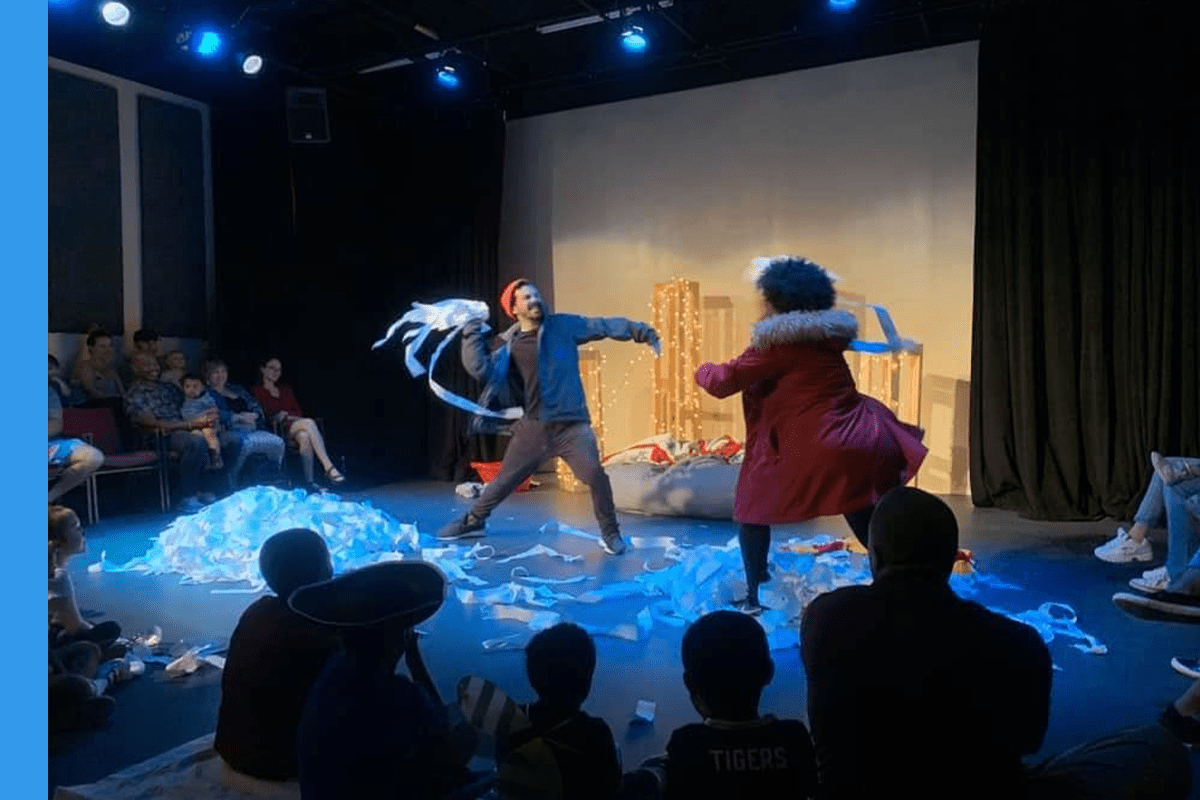Photo of two actors having a snowball fight with toilet paper.