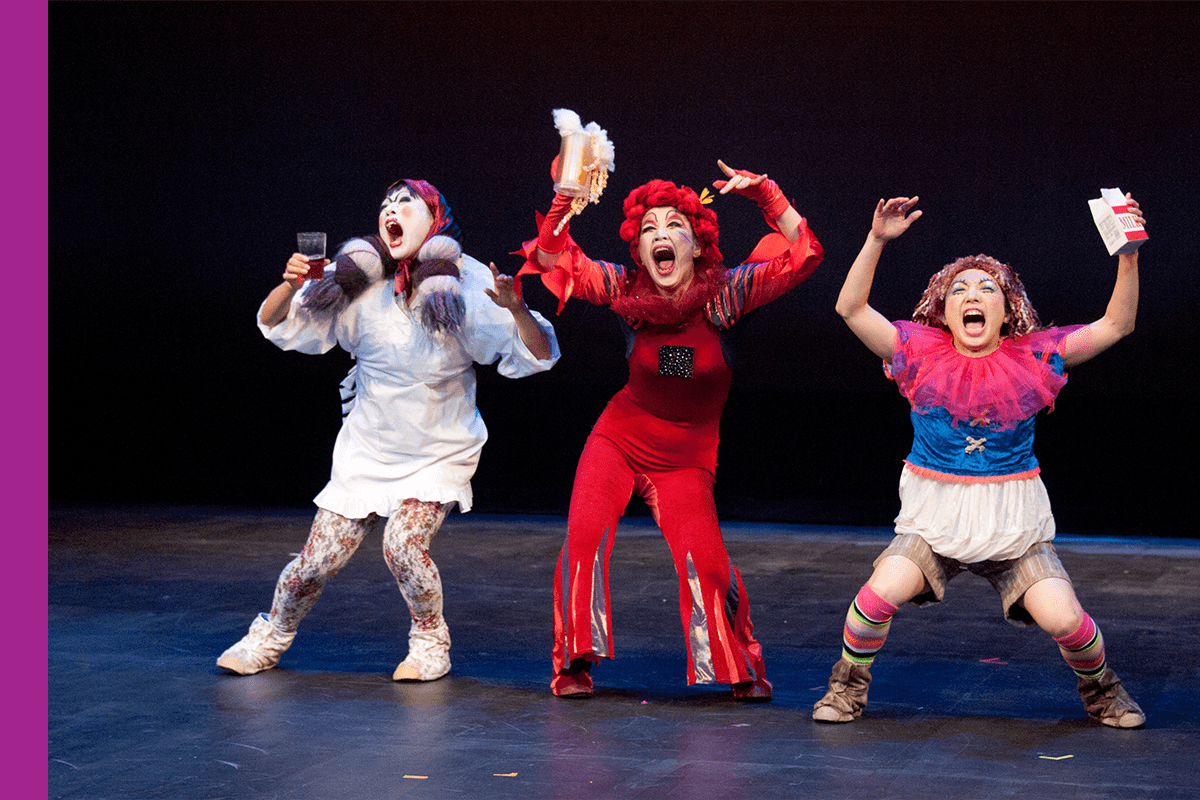 A trio of Japanese performers on a stage.