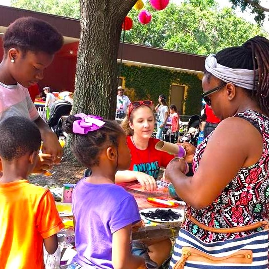 Photos of a family making crafts at a festival table.