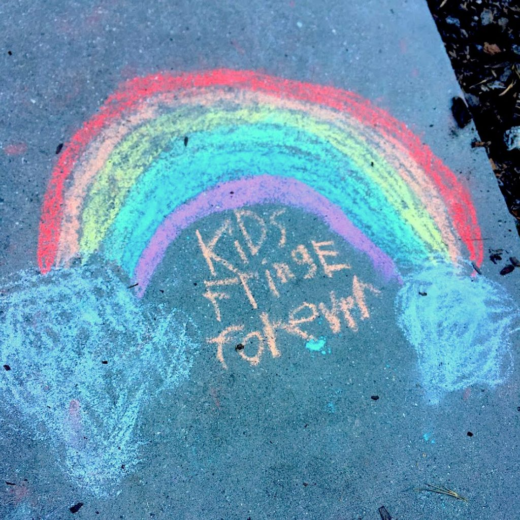 Chalk art rainbow with the words Kids Fringe Forever