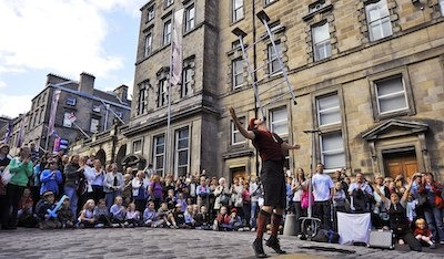 Photo of a screen performer in Edinburgh, Scotland that is performing in front of a crowd.