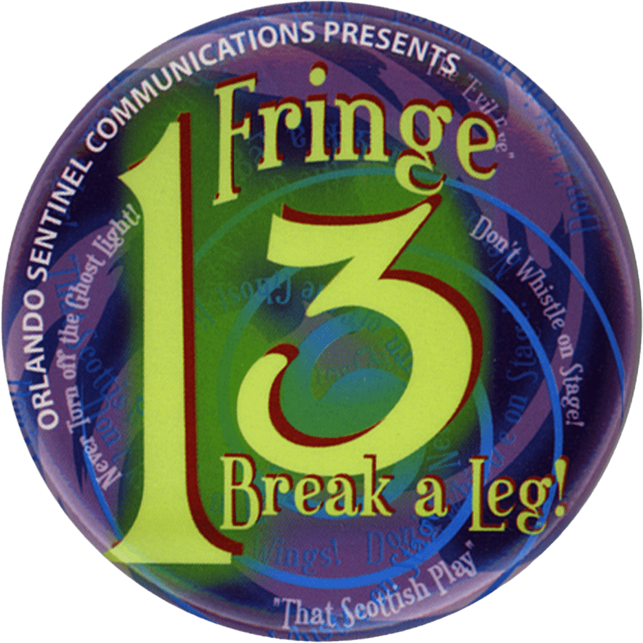 Button for the 2004 Fringe. With a blue and purple swirl and a green 13 with the words Break a Leg underneath.