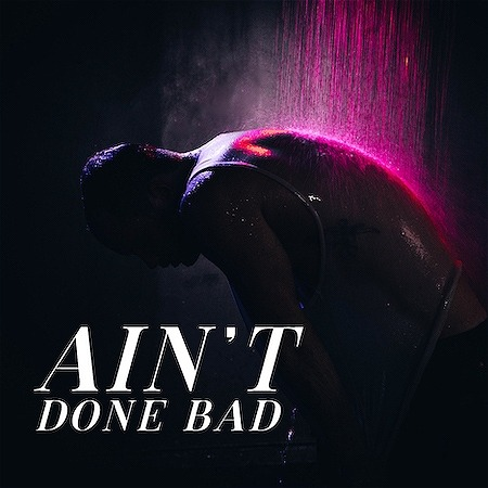"""Image showing a person facing down with what appears to be white and pink colored rain hitting their back. There is text that reads """"Ain't Done Bad"""""""