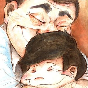 Man and boy smiling and hugging