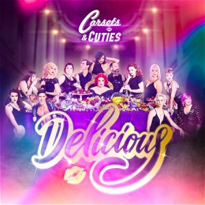 """Women sitting around a table. Text says """"Corsets & Cuties Delicious"""""""