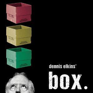 "Man looking up at a green, yellow, and red box stacked up above his head. Text says ""dennis elkins' box."""