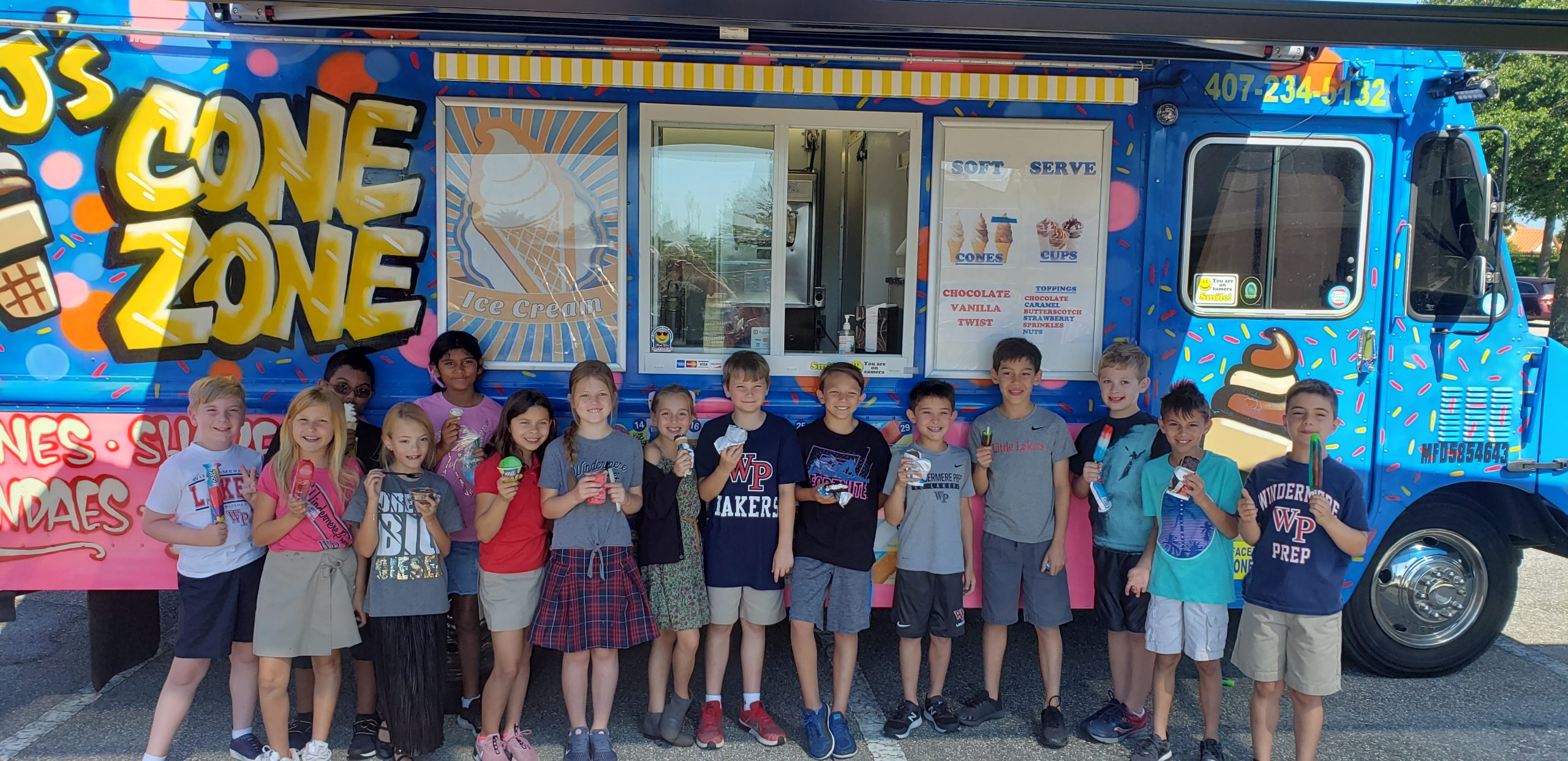 Photo of kids in front of J's Cone Zone truck.
