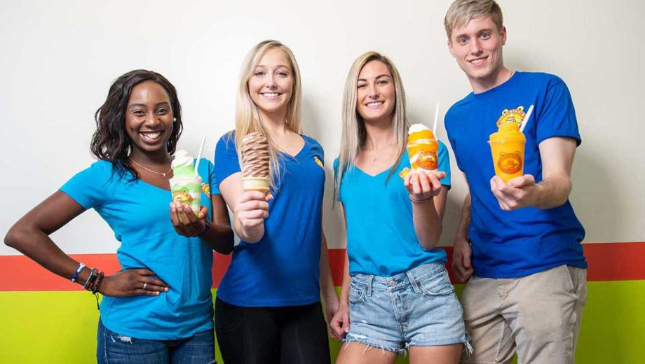 Photo of some young people grouped up holding their soft serve Italian ice.