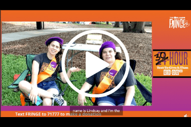 Play button for the 2021 Text To Give a Thon. Shows Lisa and Lindsay dressed as campers with sashes and patches. They are also wearing berets.